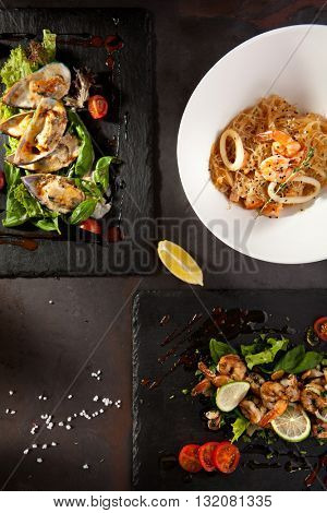 Hot Appetizers on Black Stone Background