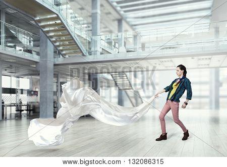 Woman pull white fabric