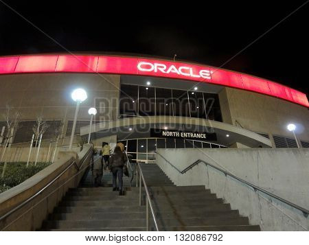 OAKLAND CA - FEBRUARY 22: People walk up stair case to the Oracle Arena before basketball game at night located in Oakland on February 22‎ ‎2011. The Oracle Arena is a multi-purpose sports and concert venue which is home to the Golden State Warriors of th