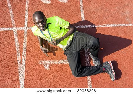 african american sprinter shows the gold medal winner