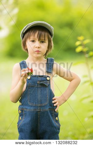 Cute Beautiful Child, Boy, Eating Strawberries And In The Park