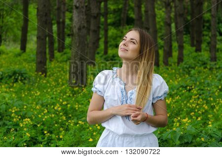 Portrait of a beautiful young woman in the forest