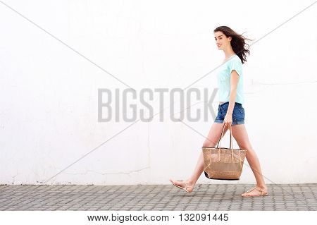 Smiling Young Woman Walking With Handbag