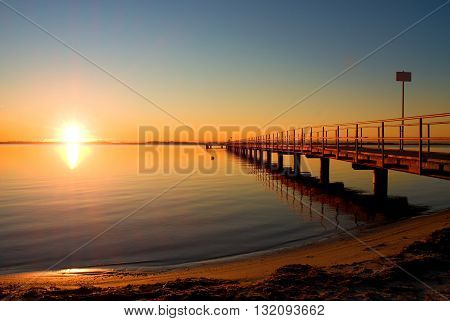 Romantic Morning In Harbor. Tourists Pier Construction Above Sea. Sunny Clear Blue Sky