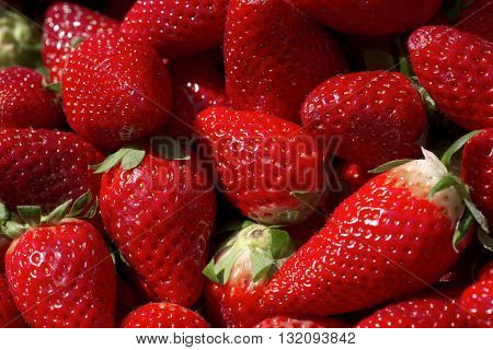 ripe fresh juicy strawberries red on the market