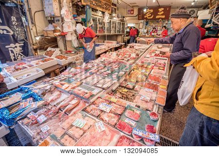 Tokyo Tsukiji Japan -November 21 2015 - Unidentified Merchants sale seafood in Tsukiji fish market of TokyoJapan. It is the biggest fish market in the world.