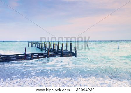 Abandoned Wooden Wharf In Sea Within Sunrise.gentle Blue Pink Color Of Sky, Blur Waves