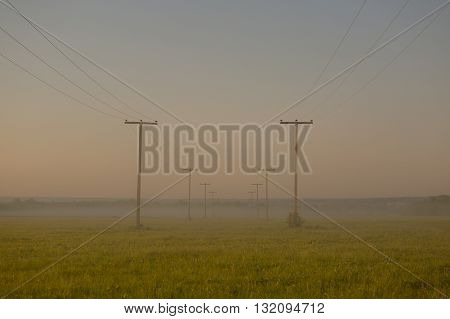 Voltage Pole With Light Morning Fog