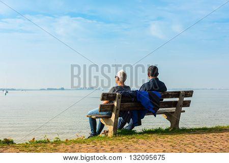 Happy Romantic Couple Enjoying Sea View