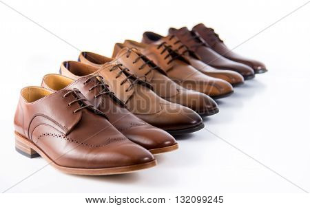 Choosing brown male shoes in fashion concept - Male foot wear isolated on the white background (brown shoes)