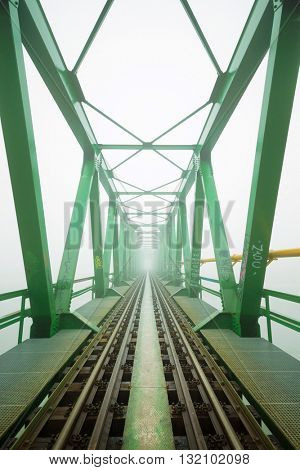 Old train bridge in fog