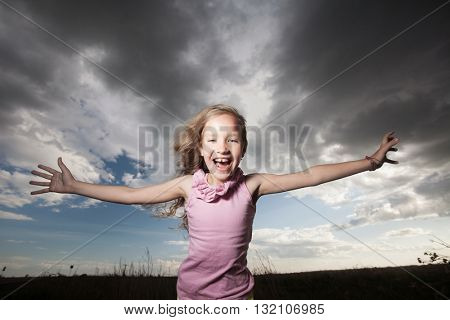 Happy smiling child at summer. Cumulonimbus