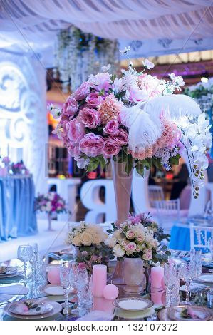 Beautiful flowers on table in wedding day in restaurant.