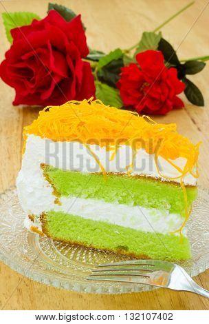 Piece of pandan cake with foi thong