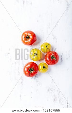 Red and Yellow Tomatoes on a Wooden Background