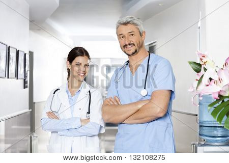 Confident Male And Female Physiotherapists Standing Arms Crossed