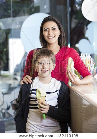 Happy Mother And Son Holding Vanilla Ice Cream Cones