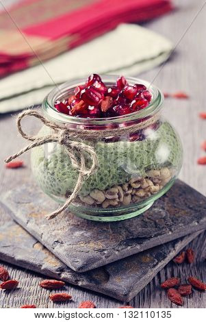 Chia seeds matcha pudding with pomegranate and chia seeds