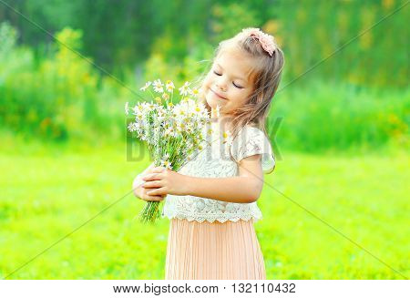 Portrait Happy Little Girl Child With Bouquet Flowers In Spring Day