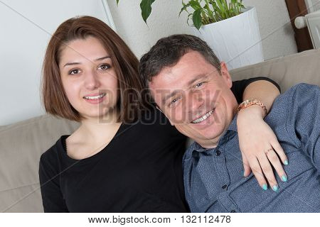 Attractive Couple On The Couch At Home In Living Room