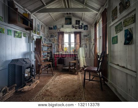 Laugharne, Pembrokeshire - May 24, 2016: The shed at Laugharne, South Wales, where Dylan Thomas did most of his writing, close to the Boat House on Cliff Road.