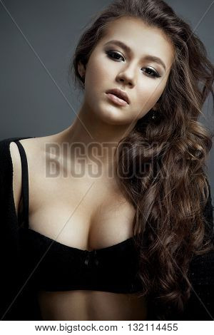 Young Beautiful Sexy Girl With Wavy Hair And Soft Skin