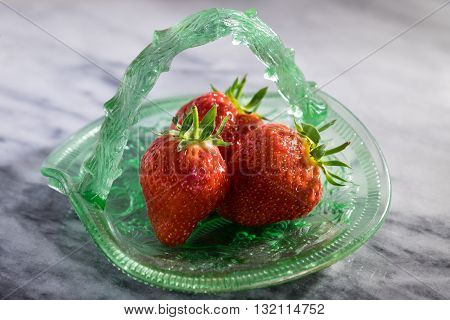 Strawberries In Glass Dish On Marble