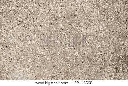 Rough textured ground with pebbles. Background.