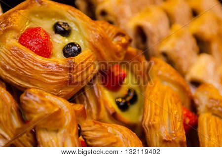 Delicious sweet puff pastry decorated with strawberry fruit