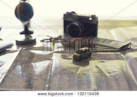 Banknote, Compass, Passport, Globe, Camera, Map, Car And Starfish Figurine For Use As Trip Vacation