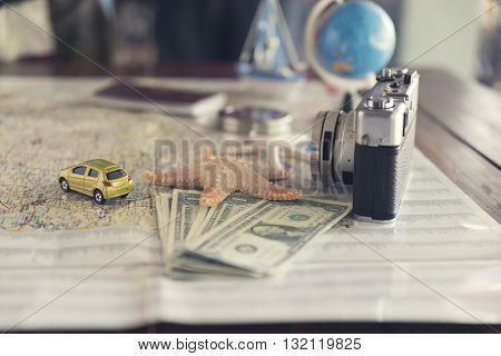 Map, Compass, Passport, Banknote, Globe, Camera, Ship Car And Starfish Figurine For Use As Trip Vaca