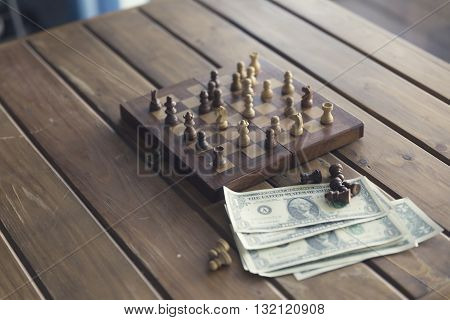 Pawn, Chessboard Game And Banknote On Wooden Table, Vintage Tone And Selected Focus