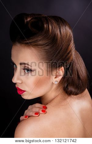 Portrait of Styled Woman with brunette Hair Style and red lips