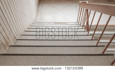 stone stairs way down in building .