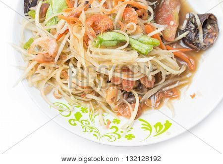 select focus papaya salad put crab on dish white Isolated background Popular local cuisine of Thailand