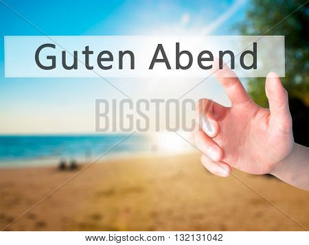 Guten Abend (good Evening In German) - Hand Pressing A Button On Blurred Background Concept On Visua