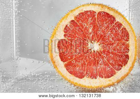 Cut grapefruit in water . design element