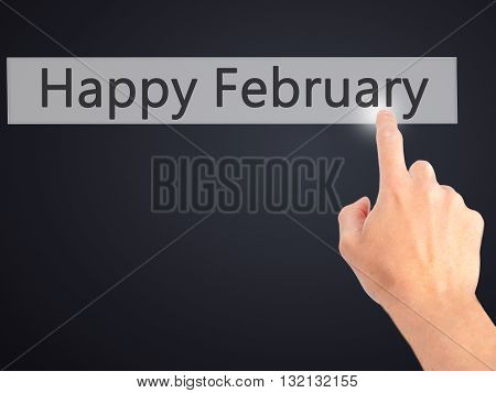 Happy February - Hand Pressing A Button On Blurred Background Concept On Visual Screen.