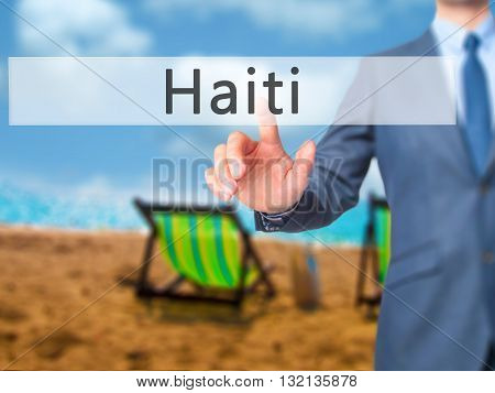 Haiti - Businessman Hand Pressing Button On Touch Screen Interface.