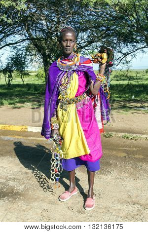 AFRICA, TANZANIA, MAY, 06, 2016 - African woman of the Masai tribe sells ornaments made of beads. The Maasai (also called Masai) are an indigenous African ethnic group of semi-nomadic people located in Kenya and northern Tanzania.