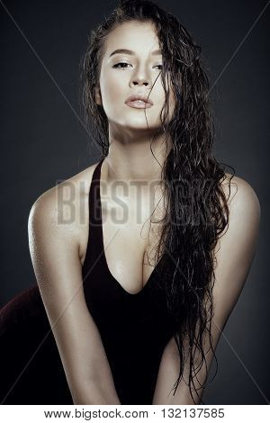 Beautiful Girl With Wet Hair On A Black Background. Young Sexy Woman.