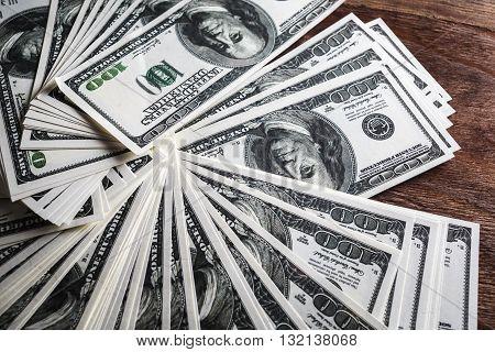 Many 100 dollar bills. Money as background.