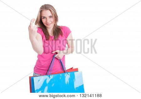 Portrait Of Beautiful Young Shopaholic With Luck Sign