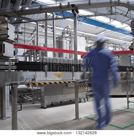 interior of a modern high automation industry with one worker
