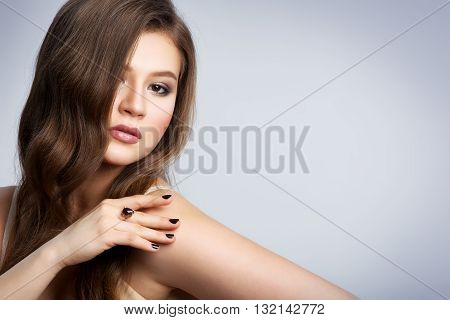 Young Beautiful Girl With Wavy Hair On A White Background. Young Sexy Woman.