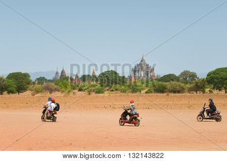 Bagan Myanmar - April 22 2016 : Group of Tourist riding E-Bike in Bagan E-Bike is one of the best ways to see the padoda's in Bagan