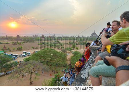 Bagan, Myanmar - April 22 2016 : Group of tourist viewing to see Sunset on the top of Shwesandaw Pagoda