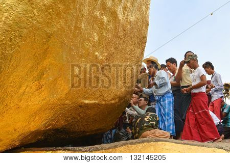 Kyaiktiyo, Mon state, Myanmar- April 24 2016: Buddhist prayers at Kyaiktiyo Pagoda (Golden Rock) One of the most Buddhist worshipful place in Myanmar.