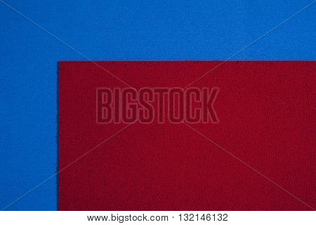 Eva foam ethylene vinyl acetate red surface on blue sponge plush background