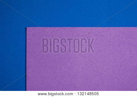 Eva foam ethylene vinyl acetate bright purple surface on blue sponge plush background